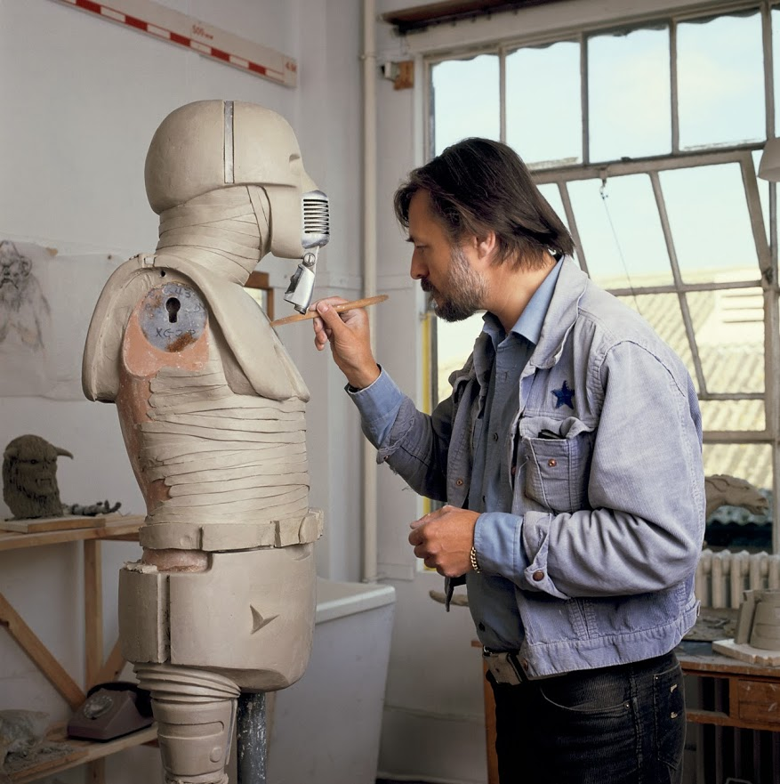 Sculptor Roy Rodgers works on the practical model of the medical droid